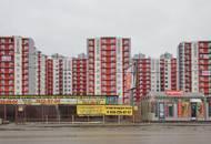 Строительство ЖК «Янинский каскад-2»: рабочие приступили к установке стеклопакетов
